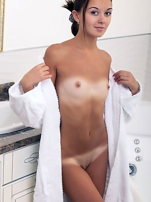 Veselin treats us to a spectacular view of her perfectly tanned body with gorgeous caramel complexion. She takes off her bath robe and take a dip in t