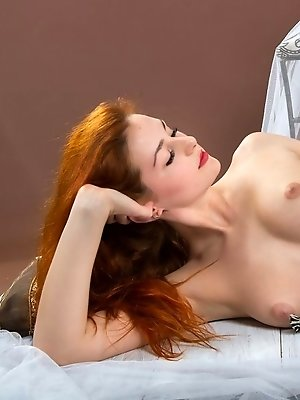 Alluring Sascha A displays her sexy, creamy body, puffy breasts and yummy pussy in front of the camera.